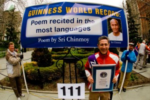 Ashrita posing with his Guinness World Record Certificate for 100 GWRs