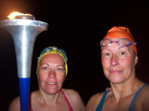 On French sands with the World Harmony Run torch (Viktoria took it on the dinghy and brought it to the shore)