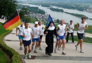 Sister Christophora, running from the monastery of St. Hildegard of Bingen to the Germania