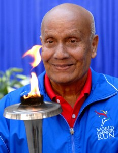 Sri Chinmoy holding the World Harmony Run Torch