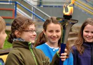 school children holding the World Harmony Run torch in Trier Quint primary school