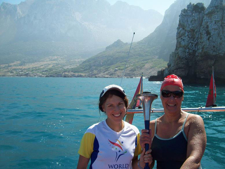 Gibraltar Straits Swim 2012 - Vasanti`s Swim to Africa, holding the World Harmony Run torch at the finish