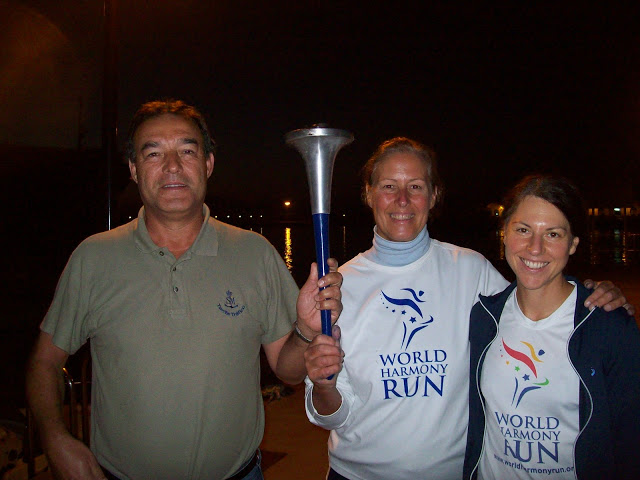 Holding the World Harmony Run torch with Rafael, head of ACNEG, the organisation for Gibraltar Strait swims - Vasanti`s Gibraltar Straits swim 2012